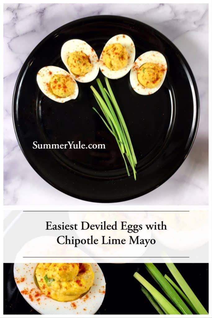 Easiest Deviled Eggs with Chipotle Lime Mayo pictured atop a black plate on a white background with chives