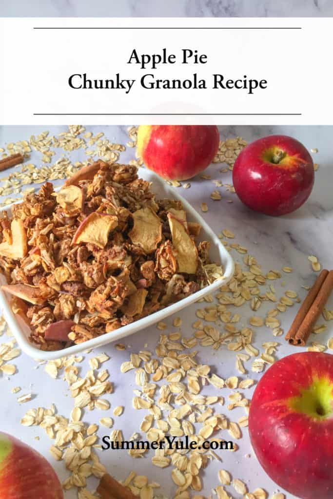 Apple Pie Chunky Granola Recipe – No Added Sugar! shown in a white bowl surrounded by rolled oats, apples, and cinnamon sticks