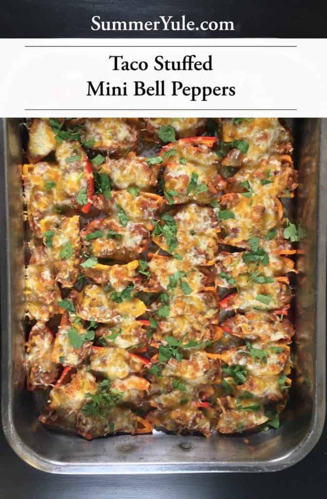 Large silver baking tray of finished Taco-Stuffed Mini Bell Peppers