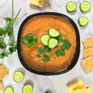 raw soup meal with crackers cheese veggies