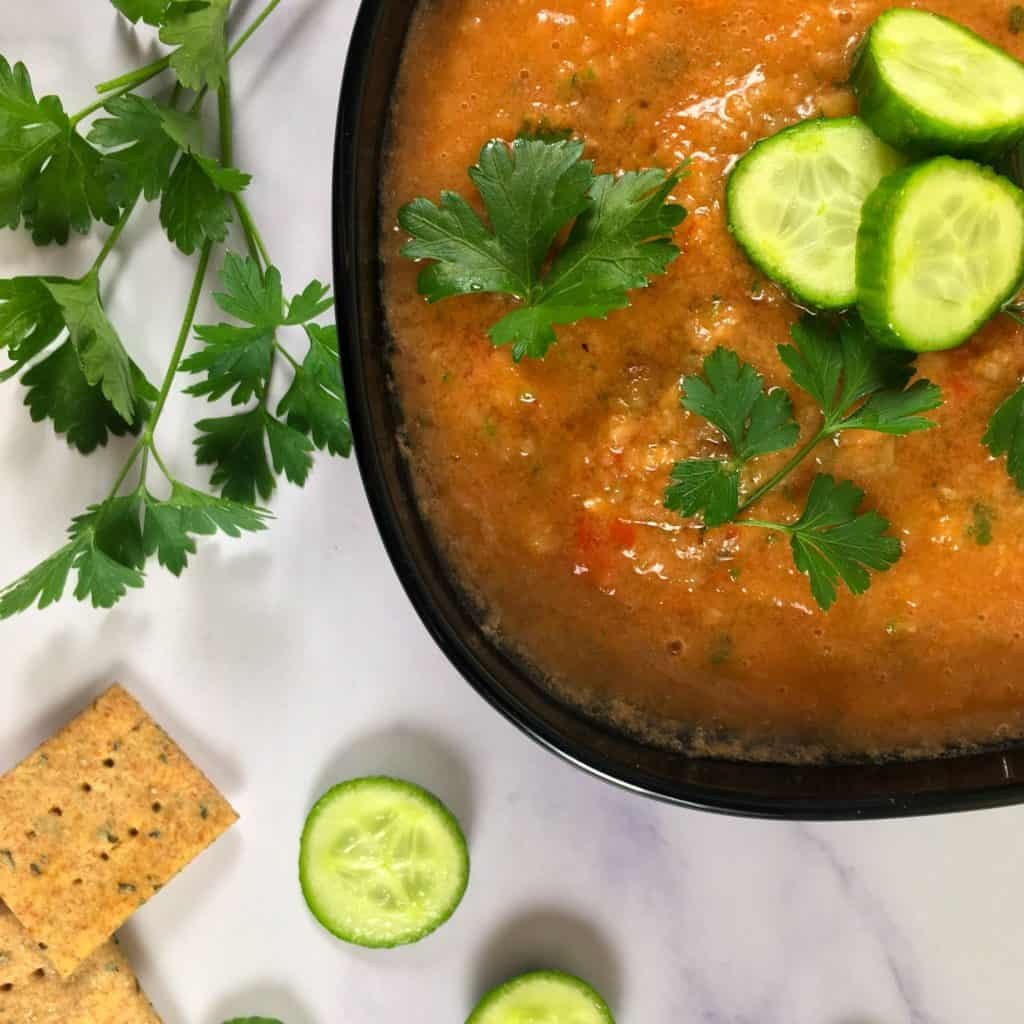 fresh tomato soup with crackers and cucumbers