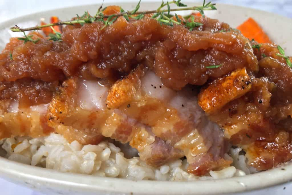 pork belly air fryer recipe covered in warm applesauce