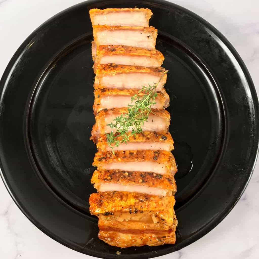 sliced air fried pork belly on a plate