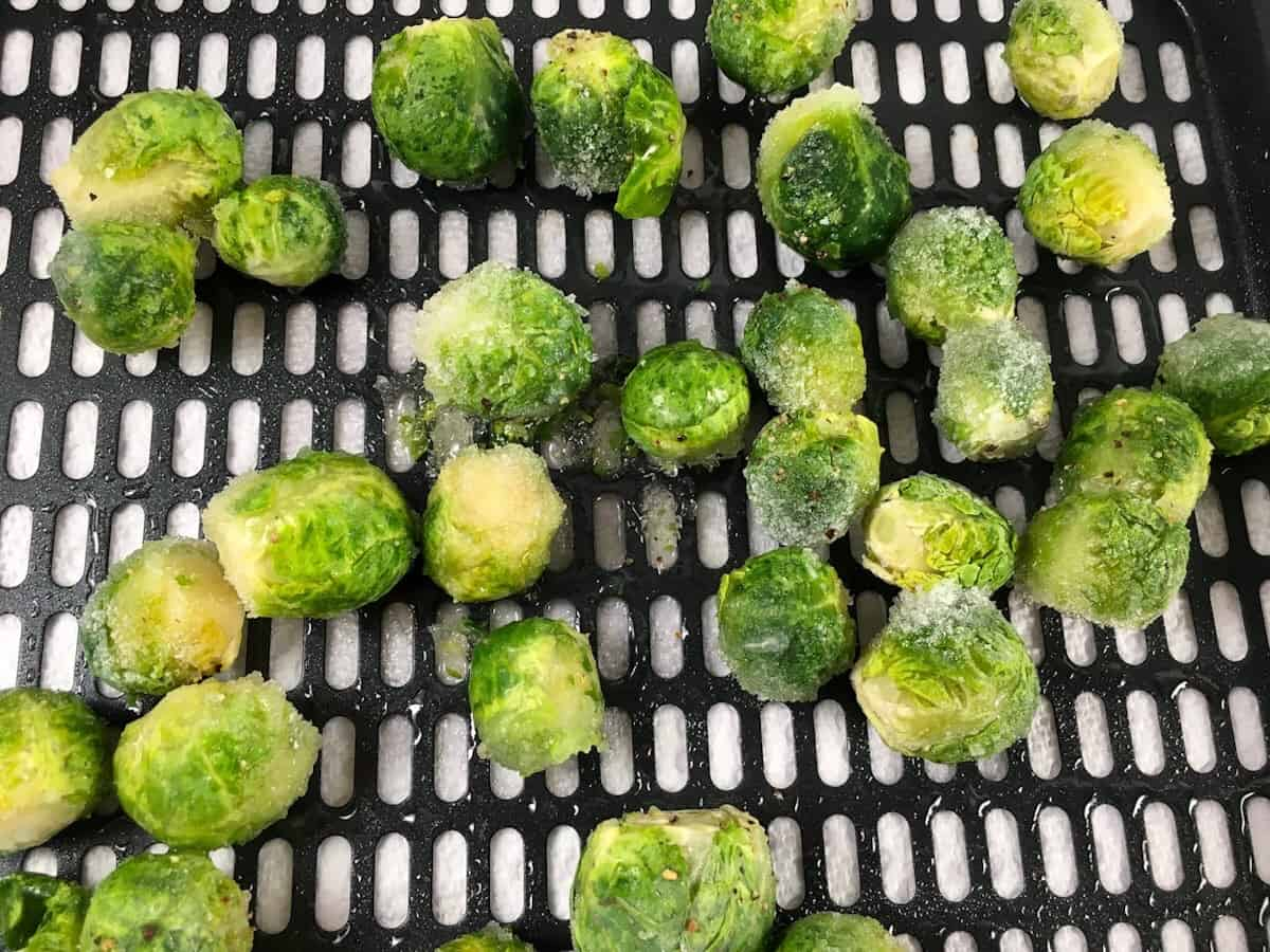 Frozen brussels sprouts on air fryer rack
