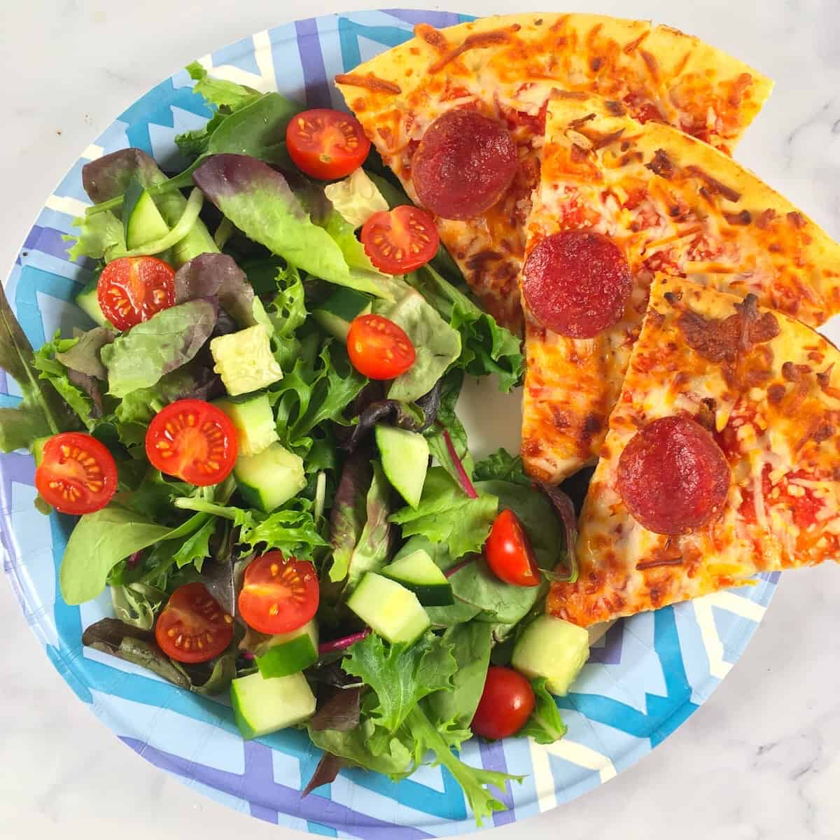 pepperoni pizza and salad meal