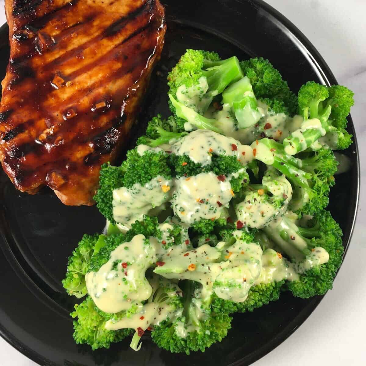 keto cheese dip and sauce on broccoli