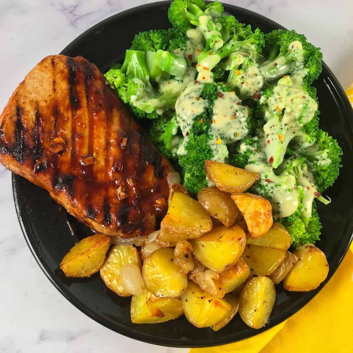 pork chop potatoes and broccoli with cheese sauce