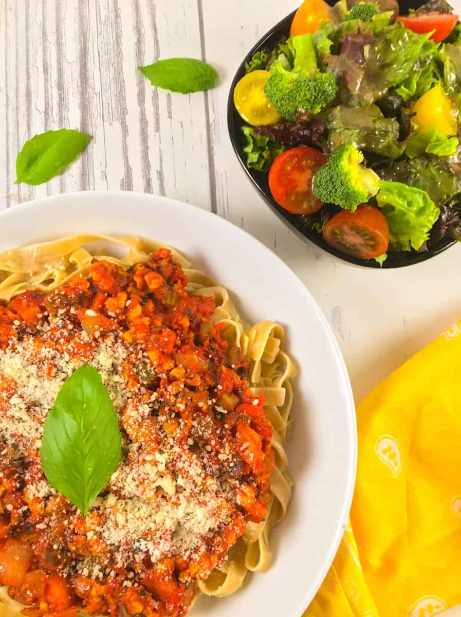 vegan bolognese and salad