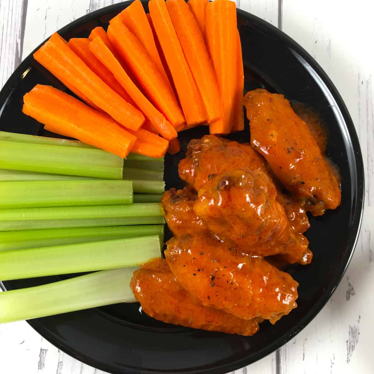 wings with Buffalo sauce and carrots and celery