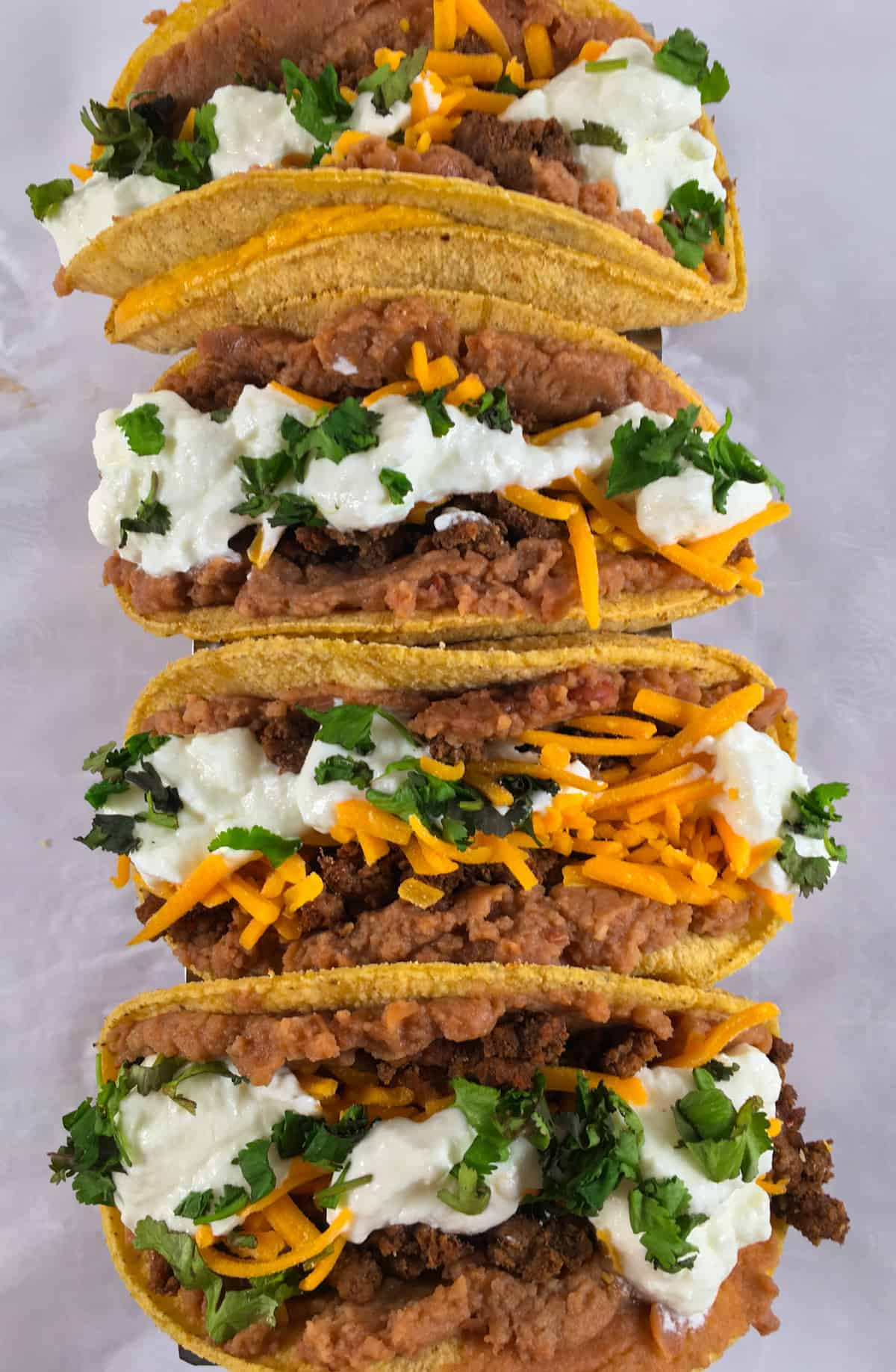 soft tacos with beef and nacho cheese