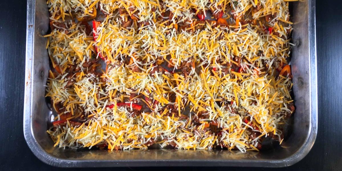 taco stuffed mini bell peppers in roasting pan
