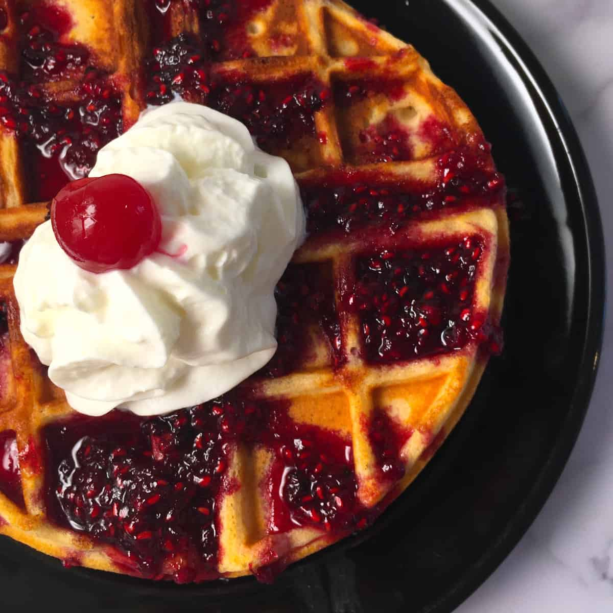 belgian waffle berry syrup whipped cream