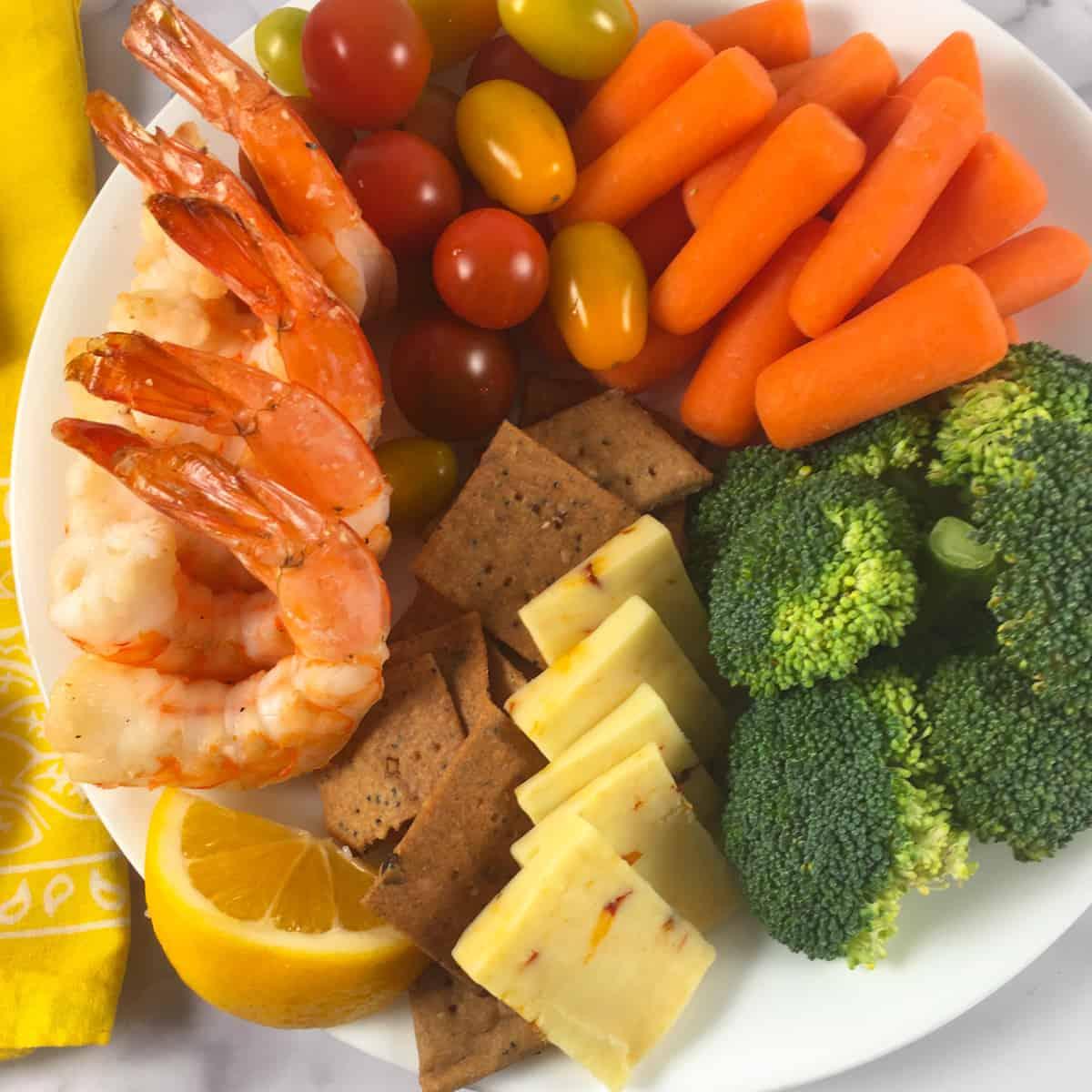 shrimp lemons cheese crackers vegetables